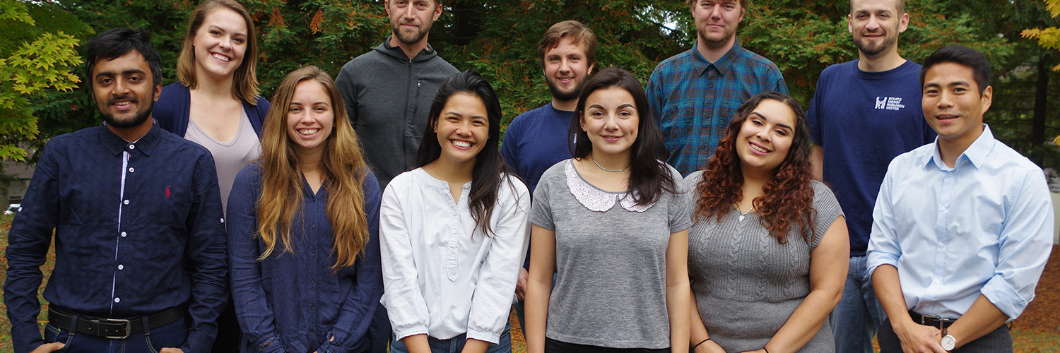 Eleven students stand in a group