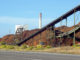 View of biomass pile and smokestack