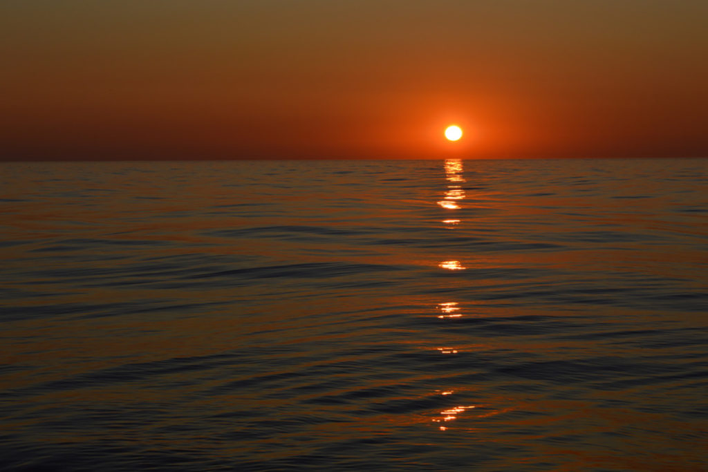 Red setting sun over the sea