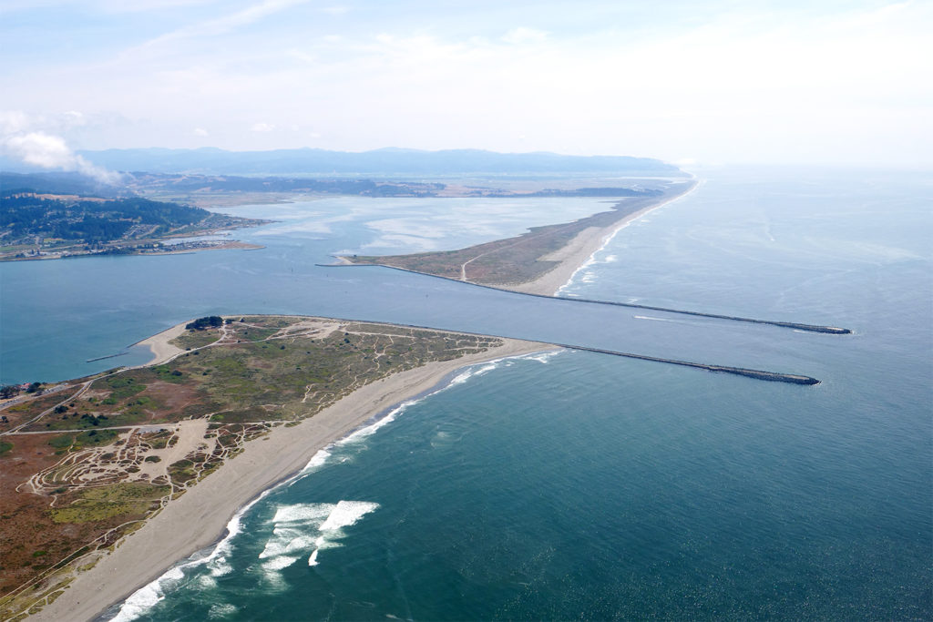 Aerial image of south Humboldt Bay and its jetties, extending into the Pacific