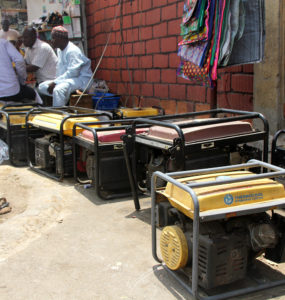 Backup generators line brick market walls