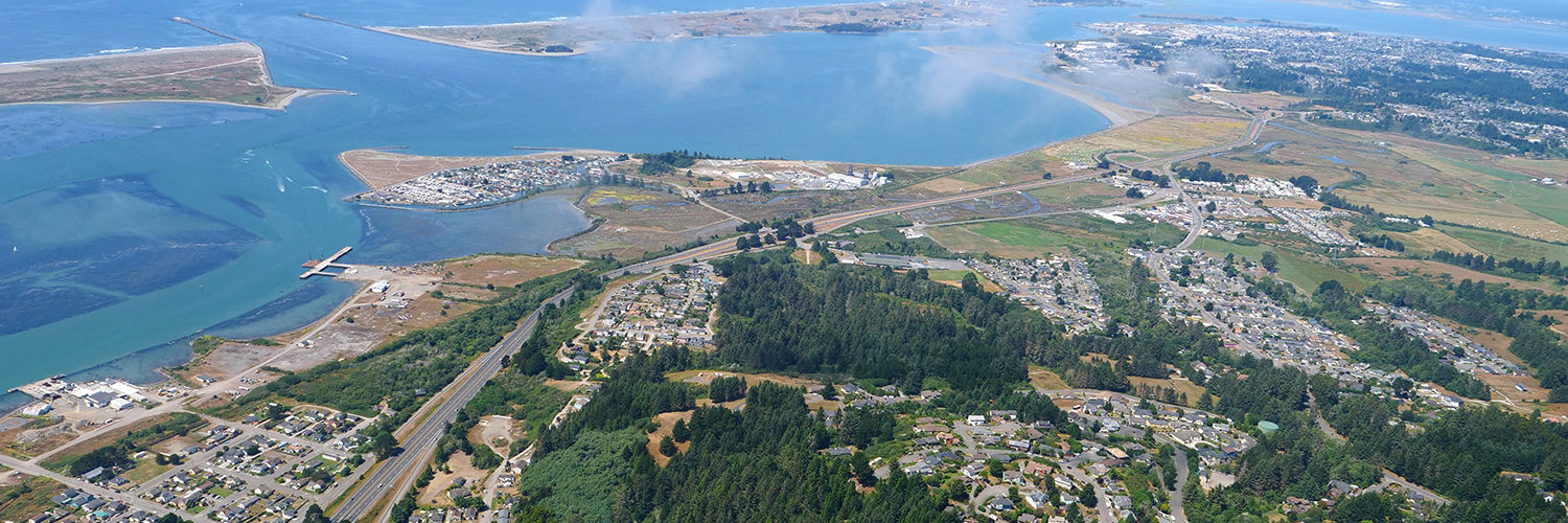 An aerial view of Humboldt Bay and the harbor jetties, from the southeast
