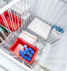 Vials inside a top-loading vaccine refrigerator