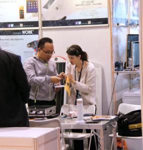 Schatz Center Senior Research Engineer Kristen Radecsky discusses technical points with a solar product designer.