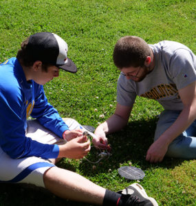A student and counselor construct a simple solar circuit