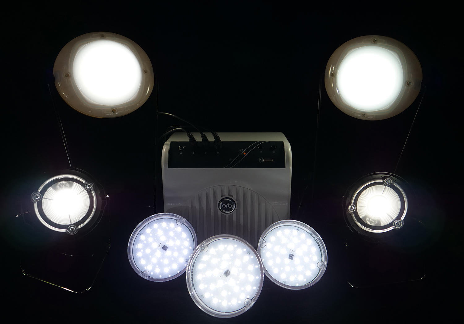 Brightly illuminated LED products sit against a black background.