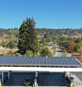 """""""Overhead shot shows solar modules on the canopy of the fueling station"""