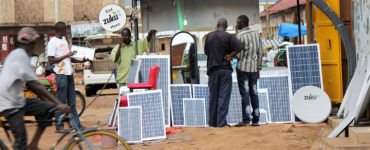 Solar panels are available for sale on a street in Uganda