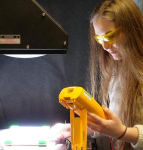 A student uses a solar simulator