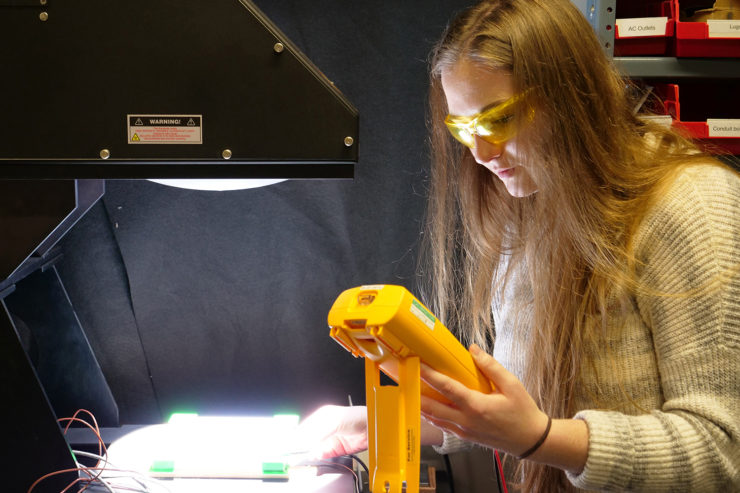 A student uses a solar simulator