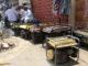 Backup generators line brick market walls