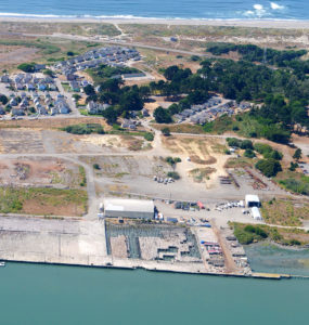 An aerial view shows a decaying dock at Redwood Marine Terminal 1