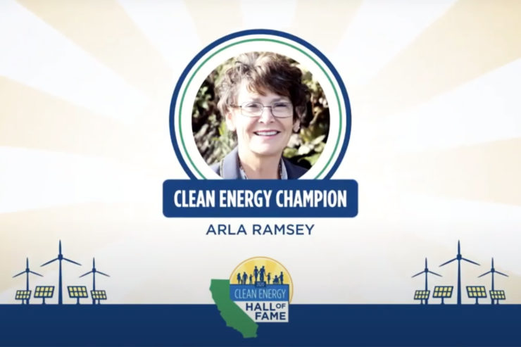 "A smiling woman with the caption ""Clean Energy Champion: Arla Ramsey"" beneath her photo."
